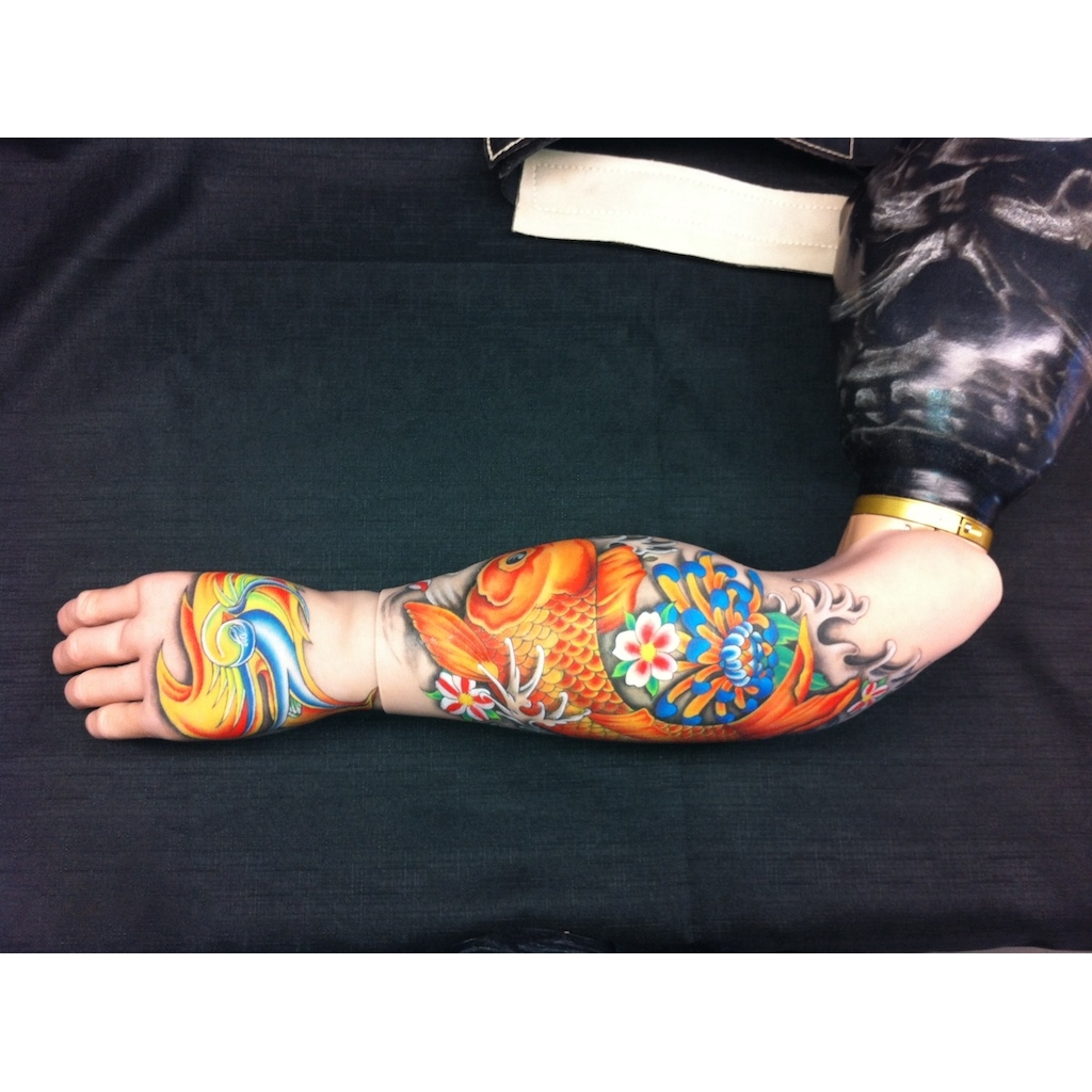 photo: painted prosthetic device by Katrie Bonanno with Japanese coy fish design. coy fish arm