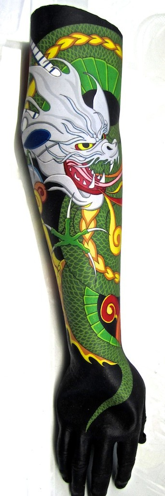 photo: Prosthetic arm tattoo painting by Hudson Valley NY artist Katrie Arena.  Dragon head and body coiled around arm.  Dragon has white head, yellow eyes, green and yellow body.  Painted in 2011. Dragon Tattoo