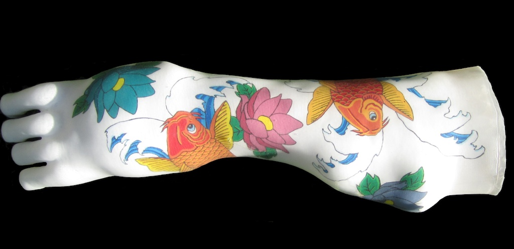 photo: Prosthetic arm covering tattoo painting by Hudson Valley NY artist Katrie Arena.  Coy fish design.  Painted in 2011. arm covering with coy fish tattoo.